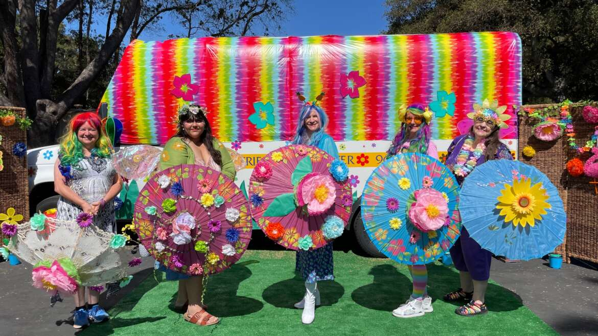 Friendship Center Blooms with Joy for Solstice Parade Parasol Performance